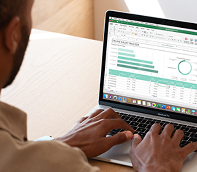 Man working on an Excel spreadsheet