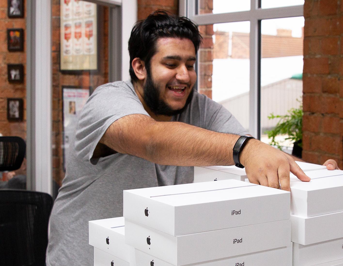 Wasim stacking iPad boxes
