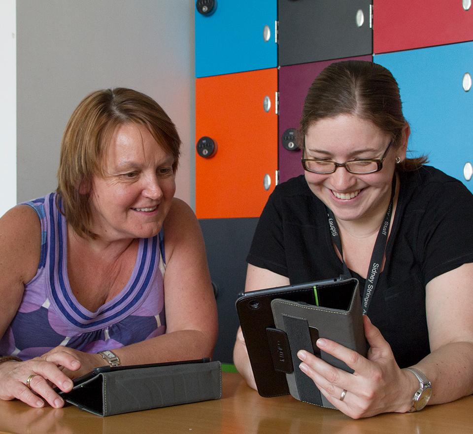 Two teachers working on iPads