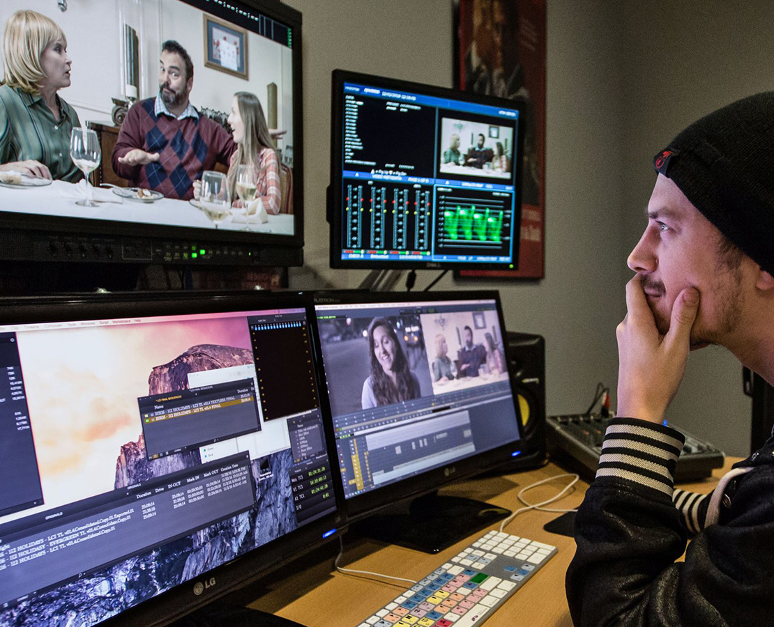 Man working on Avid Mediacentral software