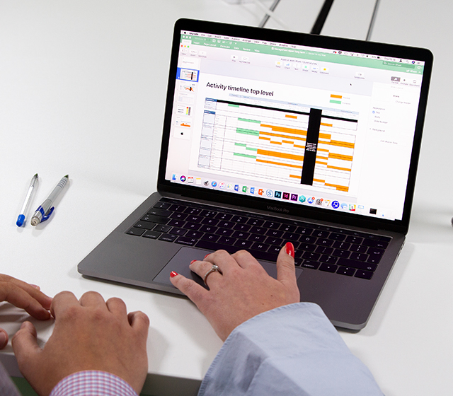 Man and woman working on an Excel spreadsheet